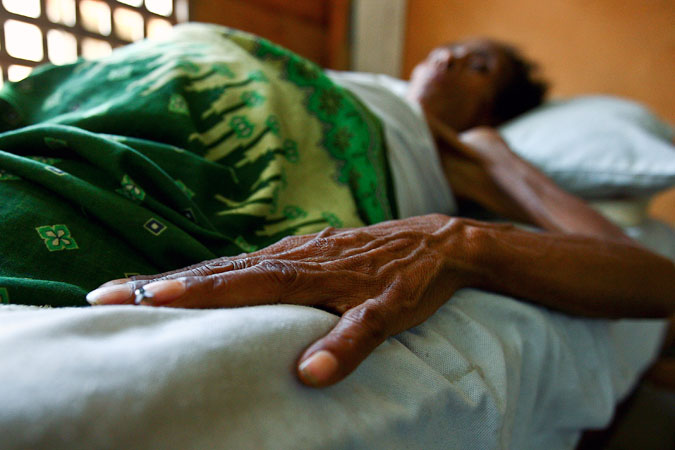 Out of focus woman in AIDS hospital. Photo: UN Photo/Martine Perret
