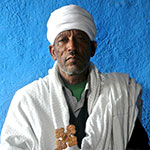 Melaskina is a priest in the Ethiopian Orthodox Church
