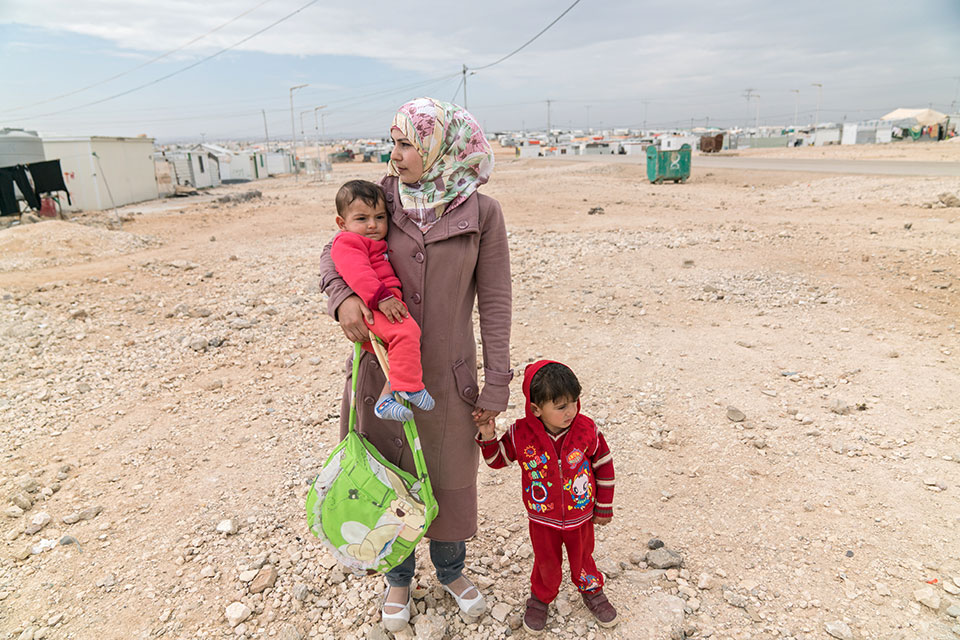 A woman refugee with her children in the Zaatari Refugee Camp in Jordan. Photo: UN Women