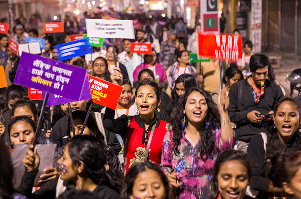 Hundreds gather in Janakpur, Nepal in December 2019, months prior to the outbreak of the COVID-19 pandemic, to take part in a Women's March to call attention for the need to reclaim women's rights and access to safe public spaces.  Photo: UN Women/Uma Bista