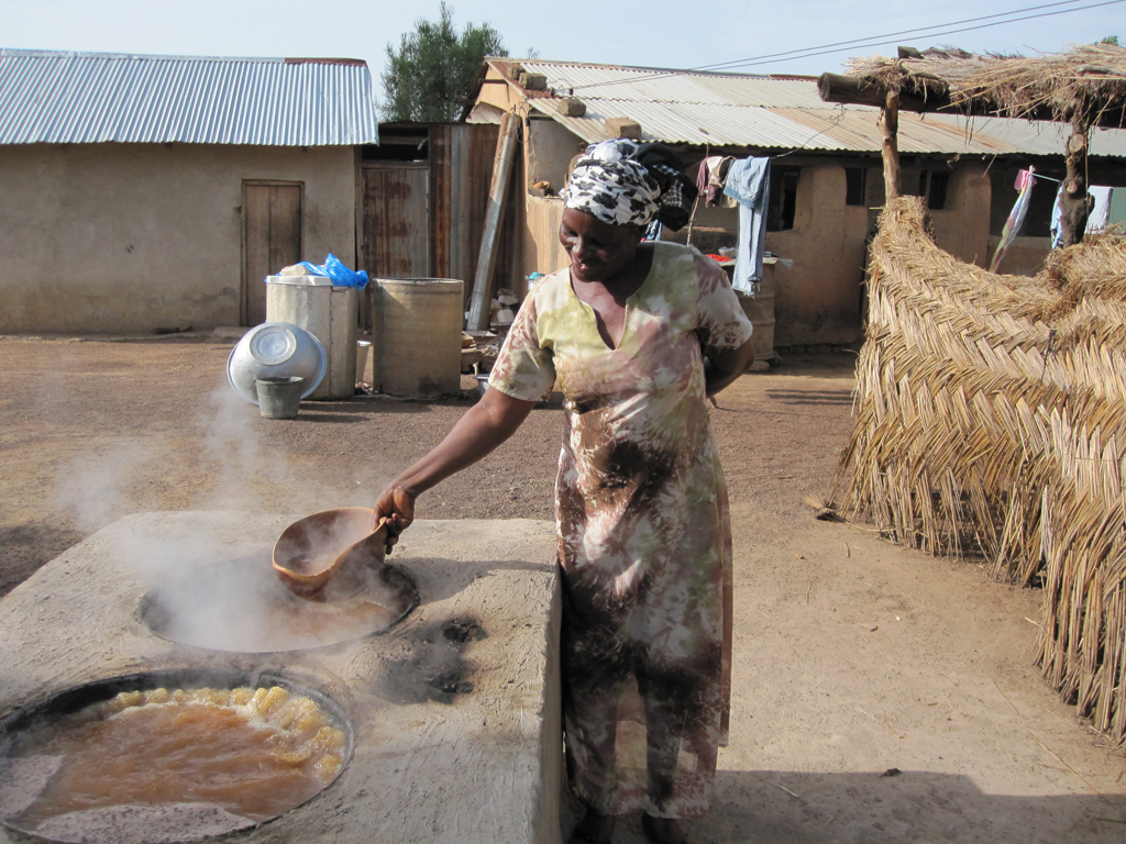 Woman using improved cookstove