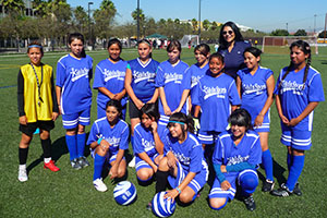 Anita DeFrantz (final row) with participants from the Kids In Sports (KIS) project, created by the LA84 Foundation, during a girls' football event in Los Angeles in 2011. KIS offers year-round programmes at sports clubs throughout Los Angeles, and has grown a girls' programme from 300 to more than 3,000. Anita DeFrantz was President of KIS from 1994 to 2012 and remains a Board member.