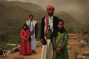Tahani, 8, is seen with her husband Majed, 27, and her former classmate Ghada, 8, and her husband, outside their home in Hajjah, Yemen, 26 July, 2010. Photo Credit: © Stephanie Sinclair/VII/Tooyoungtowed.org