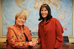 Michelle Bachelet and Cheryl Saban shake hands during a bilateral meeting on 8 March to consolidate their new partnership.