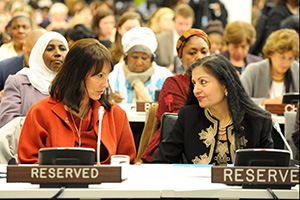 Cheryl Saban sits next to UN Women Deputy Executive Director Lakshmi Puri at the UN Commemoration of International Women's Day, prior to her meeting with Ms. Bachelet on 8 March, 2013. Photo credit: UN Women/Catianne Tijerina