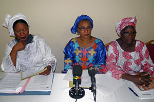 (Left to right) Soyata Maiga, Saran Keïta Diakité, President of women's peace and security network REPSFECO/Mali, and Diarra Afoussatou Thiero attend a UN Women training session on mediation prior to attending peace negotiations in Ouagadougou in April 2012.