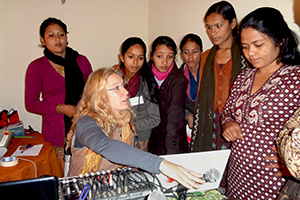 "Bianca Miglioretto explains studio operation to Nepalese women community radio broadcasters during the training ""Empowering Women Through Community Radio"" by AMARC-WIN in Kathmandu, 2011. Some of the participants never had a chance to operate a mixing console and were eager to do so, hands-on. Photo credit: Usha/K.C. of ACORAB-CIN"