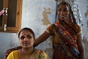 Widow Santosh Komodi (right) poses next to Savita Sharma (left), one of six human rights defenders trained by UN Women, in Vrindavan, northwestern India. Santosh is one of 62 widows who recently received the widow's pension. Photo credit: Caroline Pankert