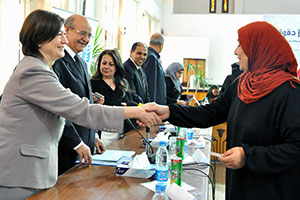 """Director of UN Women's Programme Division, Gülden Türköz-Cosslett meets with Egyptian women in Giza to hand out national ID cards as part of the """"Citizenship Initiative"""" Joint Programme."""
