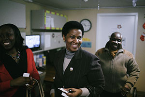 UN Women Executive Director Phumzile Mlambo-Ngcuka (centre) after saying goodbye to one of the beneficiaries of Safe Horizon's Lang House shelter, during a tour in NYC on 6 December 2013