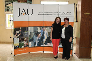 Hiba Varouqa (right) and her former teacher, Sharifa Nofa Bint Nasser (left) standing at the hall of the Jordan Applied University College of Hospitality and Tourism, which is part of UN Women's Gender Equity Seal project. Photo: Maria Fanlo