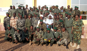 A group of armed forces personnel pose after the conclusion of one of the first training sessions at the Alioune Blondin Beye Peacekeeping School in Bamako on 20 January. Photo credit: UN Women / DIRPA