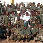 Mali soldiers posing with women in white