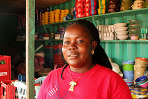 Tina Tuonyon is a 37- year-old single mother who used to sell charcoal at a small market stall. She is now a cross-border trader with a big clothing and household goods shop. Photo: UN Women/Arwen Kidd