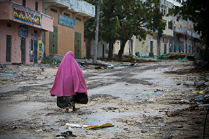 A Somali woman walks through the deserted streets of Bakara Market in central Mogadishu, a city that has endured decades of conflict.