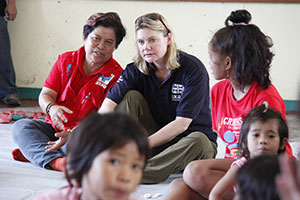 Secretary of State for International Development, Justine Greening MP talks to Corazon 'Dinky' Juliano Soliman, Filipino Secretary of the Department of Social Welfare and Development, at a school in the devastated city of Tacloban in the Philippines on 24 November 2013. Photo: Russell Watkins/Department for International Development
