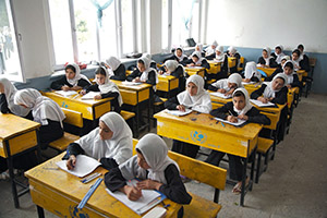 Girls study at the Sultan Razia High School in Mazar-e-Sharif, Balkh Province. (Photo: UN Photo/Shehzad Noorani)