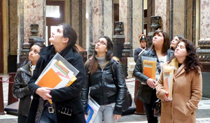Six of the 25 young women leaders who took part in the tutorials visit the Legislative Palace in Montevideo.