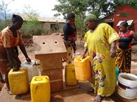 Water kiosk supervisors such as 29-year-old Maria (left) ensure an equitable distribution of clean water in Kingolwira.