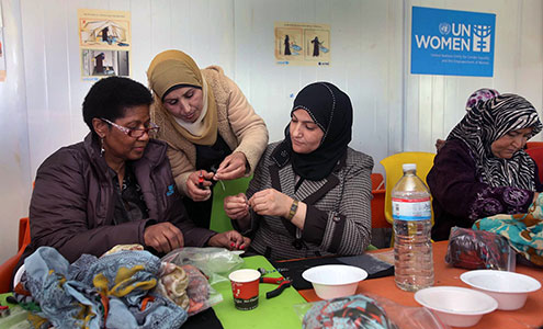 UN Women Executive Director Phumzile Mlambo-Ngcuka takes part in jewelry-making activities during a visit to the Za'atari refugee camp for Syrian refugees during her trip to Jordan from 20 to 23 February 2014. Photo: UN Women Jordan/Abdullah Ayoub