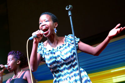 "Umuhire Solange Liza, winner of the ""Sing yes to Kigali City"" song competition, performs at an event at the Amahoro Petit National Stadium in Kigali to implement the community mobilization strategy in the Kigali Safe City Programme, and commemorate the International Day for the Elimination of Violence against Women on 25 November 2014. Photo: One UN Rwanda."