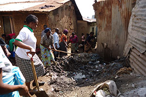 Unclogging the drains; the Galima women conduct a community cleanup campaign