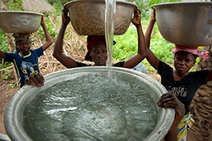 Collecting and carrying water, burdensome reality for women