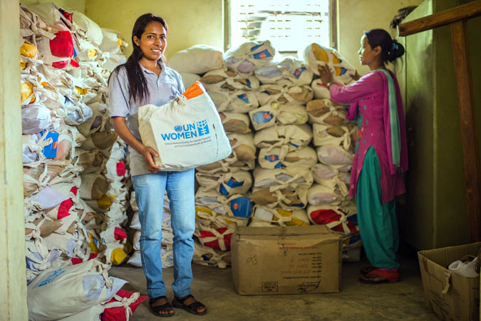Kalpana BK with Ashmita Tamang storing dignity kit provided by UNWomen in Panchkhal on July 1, 2015