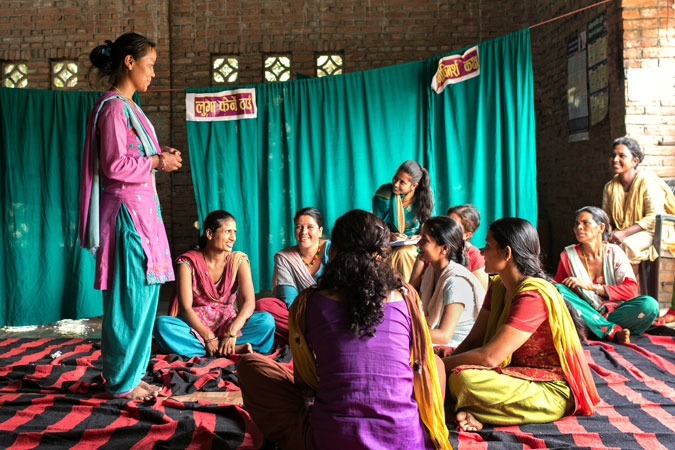 Ashmita Tamang, a psychosocial counsellor speaks during group counselling in Panchkhal, Nepal on July 1, 2015