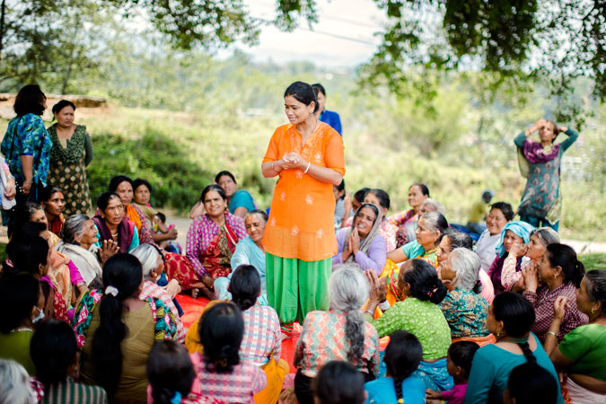 women gather in Dharmasthali to learn more about relief, services and about women's rights