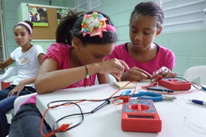 Female adolescents and girls as young as 11 years old are taking classes in robotics, auto-mechanics, computer programing and electronics.