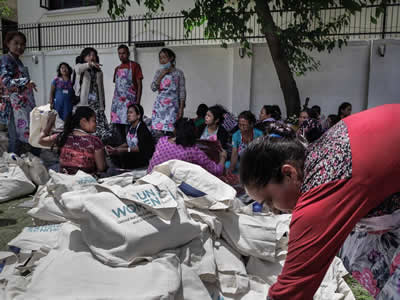 Nepal volunteers preparing dignity kits