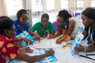 "Edith Chukwu (right), helps guide fellow Girl Guides at a train-the-trainers workshop in Zambia to help roll out the ""Voices against Violence"" non-formal education curriculum. Photo: UN Women/Urjasi Rudra"