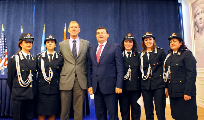 Anila Popa (far right) was one of five women police officers to graduate from the ICITAP-UN Women training in 2015. They stand alongside Bill Morrell, Strategic Police Advisor, ICITAP Albania (centre-left) and the Director of the Albanian State Police, Haki Çako (centre-right), who is also a HeForShe champion.   Photo: UN Women/Besnik Bak