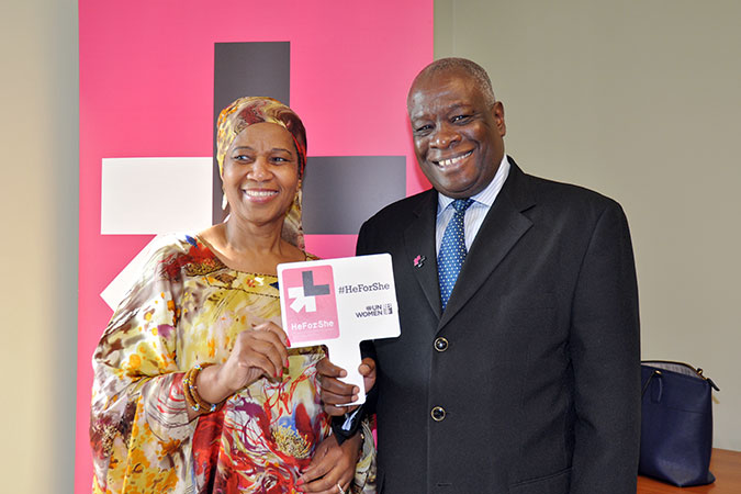 Executive Director Phumzile Mlambo-Ngcuka pins Chief Justice Marston Gibson to recognize him as a HeForShe. Photo: UN Women/Ricardo Leacock