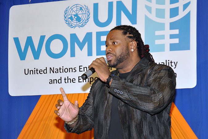 """UNiTE artist and HeForShe Champion Michael """"Mikey"""" Mercer performing his song """"Turn up the Love"""" at the Step It Up for Gender Equality event on 31 October, Barbados. Photo: UN Women/Ricardo Leacock"""