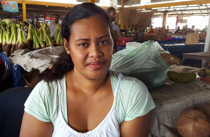 Sofia Talei now has only coconuts to sell at the market after her farm was destroyed by Cyclone Winston. Photo: UN Women/Kasanita Isimeli
