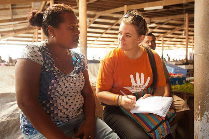 Lusiana Bulu, 38, talks to UN Women's Ellie van Baaren about the challenges she and other market vendors are facing in the wake of Tropical Cyclone Winston. Credit: UN Women/Murray Lloyd
