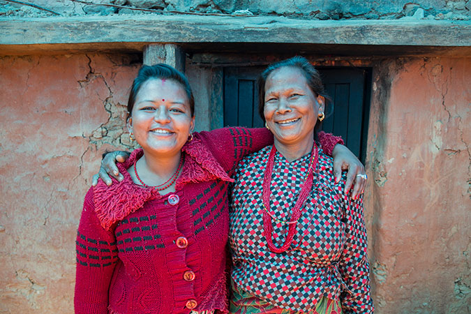 Kalpana Shrestha (left) has received psychosocial counselling for her trauma, as well as support from her mother-in-law (right), pictured here in Sanosirubari VDC -2 in Chautara, Sindhupalchwok, Nepal. Photo: UN Women/N. Shrestha