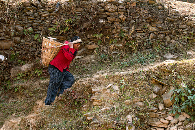 Kalpana Shrestha doing her day-to-day chores in Sanosirubari VDC-2 at her home in Chautara, Sindhupalchwo, Nepal. Photo: UN Women/N. Shrestha