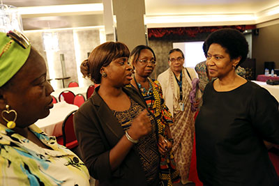 UN Women Executive Director Phumzile Mlambo-Ngcuka attended a briefing session on the Community Dialogue Initiative, led by a team of facilitators from the Ministries of Internal Affairs and Gender, Children and Social Protection. Photo: Stephanie Raison