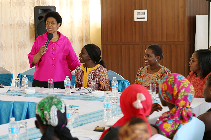 UN Women Executive Director Phumzile Mlambo-Ngcuka met with an excited group of adolescent girls to listen to their ideas and challenges in Liberia. Photo: UN Women/Stephanie Raison