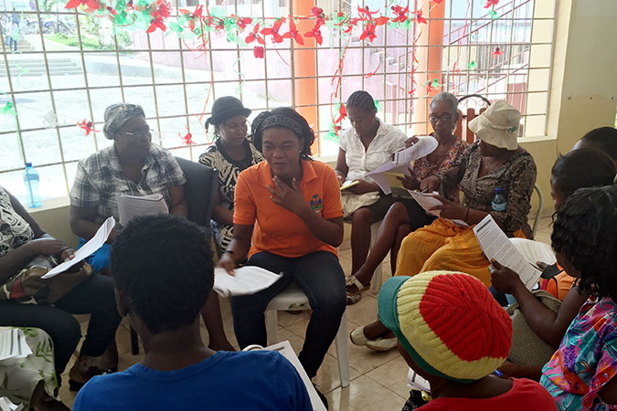 Women affected by  Hurricane Matthew in Haiti come together in safe and social women's spaces. Photo: UN Women/Maria Sanchez