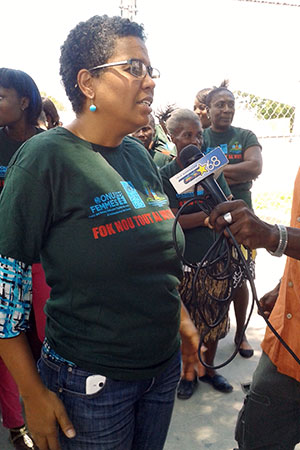 Nadege Beauvil speaks to the media at a rally with women associations and the Ministry of Women Affairs on 7 August, 2015, two days ahead of the elections. Photo: UN Women/Alide Andral