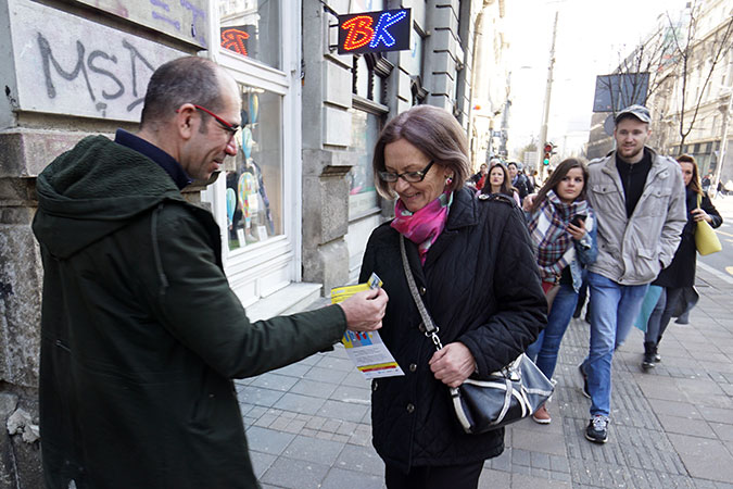 Distribution of leaflets with statistics on the position of women and men in Serbia on the streets of Belgrade, as part of the International Women's Day 2016 campaign. Photo: UN Women/Dragan Kujundzic