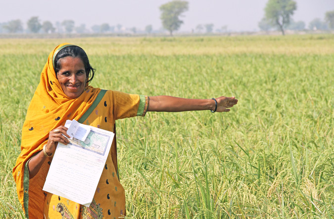 Durdana, a once landless woman farmer, proudly shows off her land and Land Tenancy Agreement in Dadu District, Sindh Province, Pakistan. Photo: UN Women/Faria Salman
