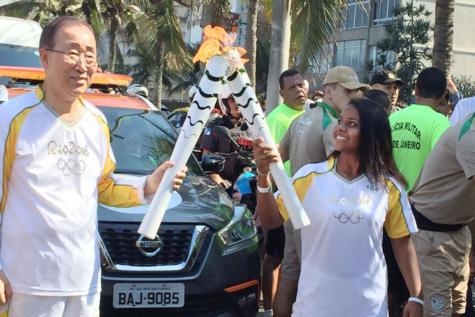 UN Secretary-General Ban Ki-moon passes the Olympic Flame to Thaiza Vitória, (link to her photo essay) a 15-year-old Brazilian handball player and member of the 'One Win Leads to Another' programme in Rio de Janeiro. Photo: UN Women/Isabel Clavelin