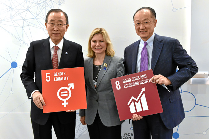 UN Secretary-General Ban Ki-moon, UK International Development Secretary Justine Greening, and World Bank Group President Jim Yong Kim hold up visual icons for a couple of the new Sustainable Development Goals. Photo: swiss-image.ch/Michael Buholzer