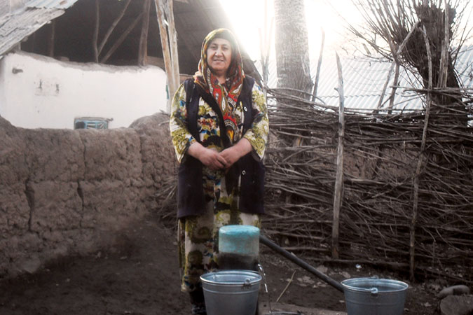 """Surayo Mirzoyeva, 41, took part in a self-help group supported by the UN Women project """"Empowering abandoned wives of migrant workers in Tajikistan,"""" which has provided more than 3,000 villagers in Fathobod, Tajikistan, with clean drinking water. Photo: UN Women/Humairo Bakhtiyar"""