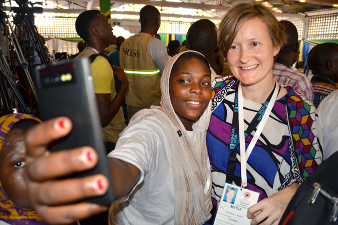 Taking selfies with a fellow woman radio reporter and member of Tanzania Media Women's Association among the press pack at the 2015 awarding of certificates by the National Electoral Commission to the president and vice-president elect on 30 October 2015. Photo: UN Women Tanzania